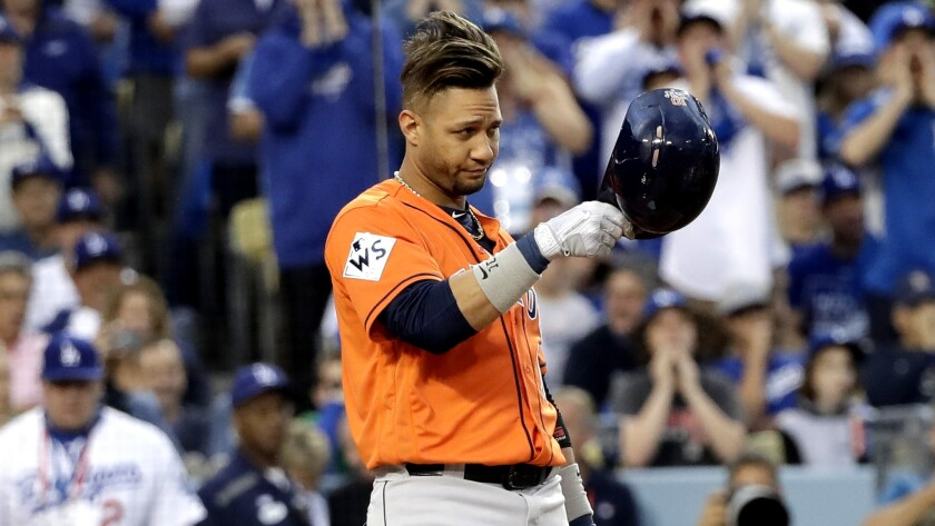 Astros first baseman Yuli Gurriel tips his helmet toward Dodgers pitcher Yu Darvish before getting into the batter's box during the first inning of Game 7.