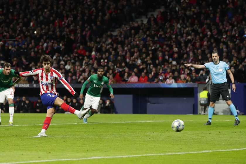 Atletico Madrid's Joao Felix scores a penalty kick during the Champions League Group D soccer match between Atletico Madrid and Lokomotiv Moscow at Wanda Metropolitano stadium in Madrid, Spain, Wednesday, Dec. 11, 2019. (AP Photo/Manu Fernandez)