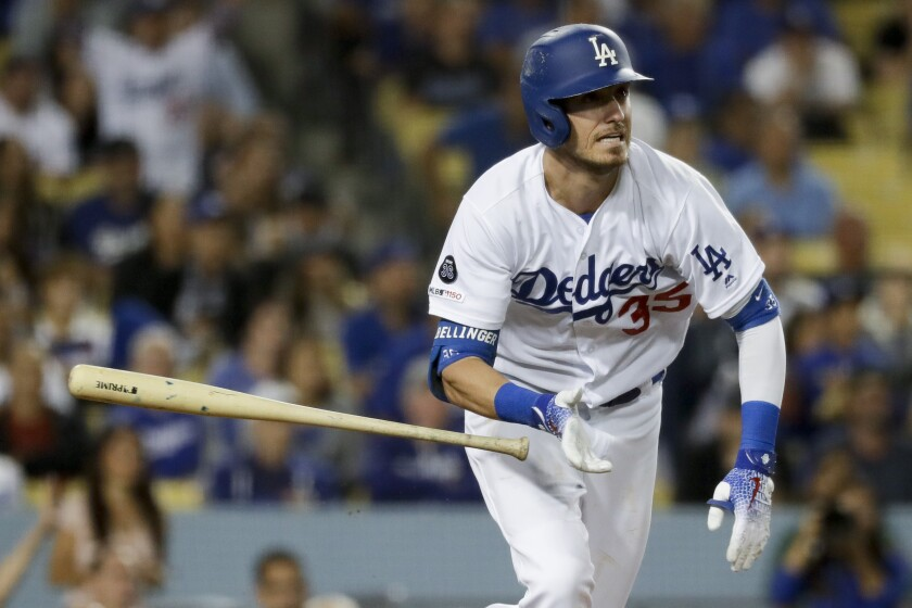 Los Angeles Dodgers' Cody Bellinger watches his two-run double against the Tampa Bay Rays during the seventh inning of a baseball game in Los Angeles, Tuesday, Sept. 17, 2019. (AP Photo/Chris Carlson)