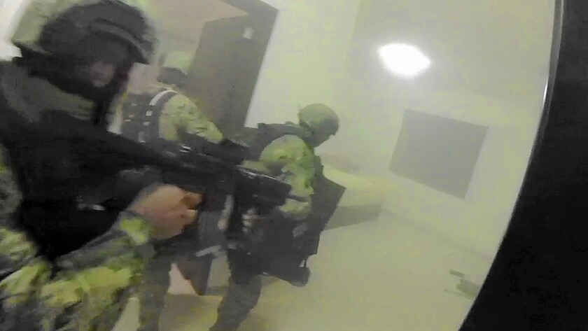 """Mexican marines storm a home during the operation to recapture Joaquin """"El Chapo"""" Guzman in Los Mochis, Mexico, in an image from video taken Jan. 8, 2016."""