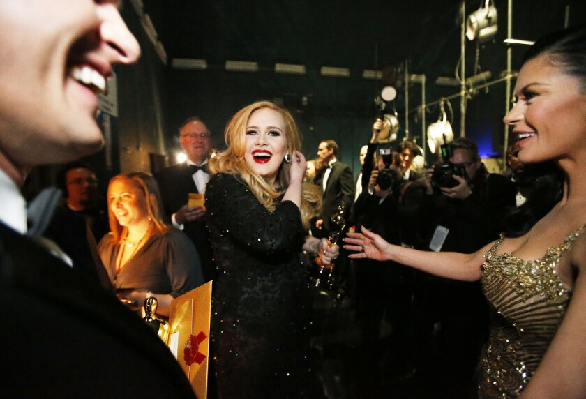 """Adele after accepting her Oscar for """"Skyfall."""""""