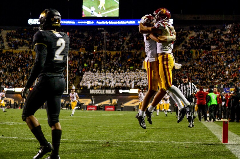 USC wide receiver Tyler Vaughns, left, and quarterback Kedon Slovis celebrate a touchdown during the fourth quarter of the Trojans' win over Colorado on Friday.