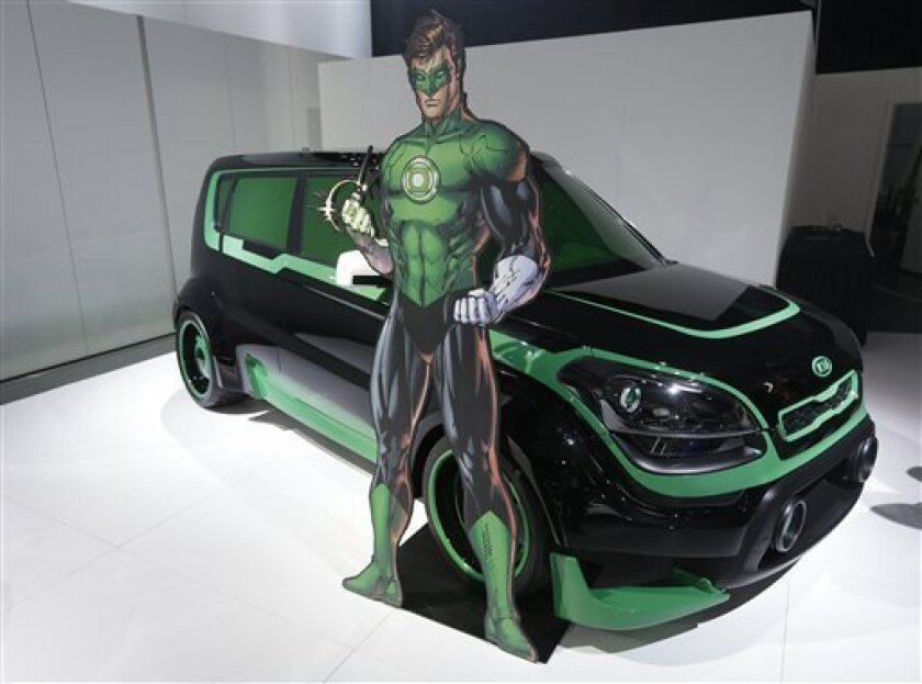 """The Green Lantern-wrapped Kia Soul is on display at the North American International Auto Show in Detroit, Tuesday, Jan. 15, 2013. The Batman-decorated Kia Optima and the Green Lantern-wrapped Kia Soul are at the South Korean automaker's exhibit to promote an effort to fight hunger in Africa. Features include the Green Lantern's symbol on the Soul's wheels. The vehicles were created as part of a partnership involving DC Entertainment. The """"We Can Be Heroes"""" effort is promoted in part by the use of Justice League characters. (AP Photo/Carlos Osorio)"""
