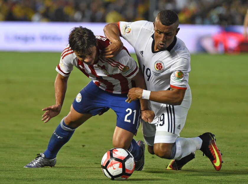 Paraguay's Oscar Romero, left, and Colombia's Farid Diaz vie for the ball during the Copa America Centenario match at the Rose Bowl on June 7.