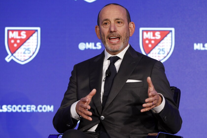FILE - In this Feb. 26, 2020, file photo, Major League Soccer Commissioner Don Garber speaks during the Major League Soccer 25th Season kickoff event in New York. Major League Soccer said Saturday, Aug. 8, 2020, it will resume its season once the MLS is Back tournament in Florida wraps up. The league's 26 teams will each play 18 games, with the first between FC Dallas and Nashville set for Aug. 12.(AP Photo/Richard Drew, File)