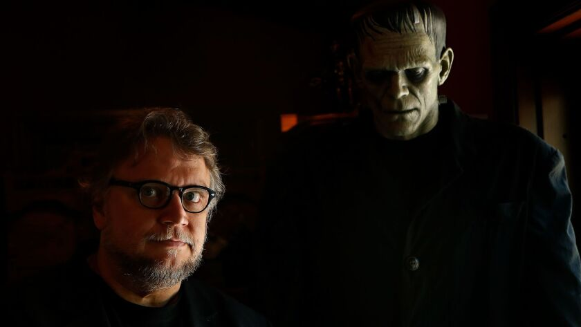 Director Guillermo del Toro stands with a sculpture of Boris Karloff as Frankenstein's monster in 2016 in the Westlake Village home he's dubbed Bleak House.