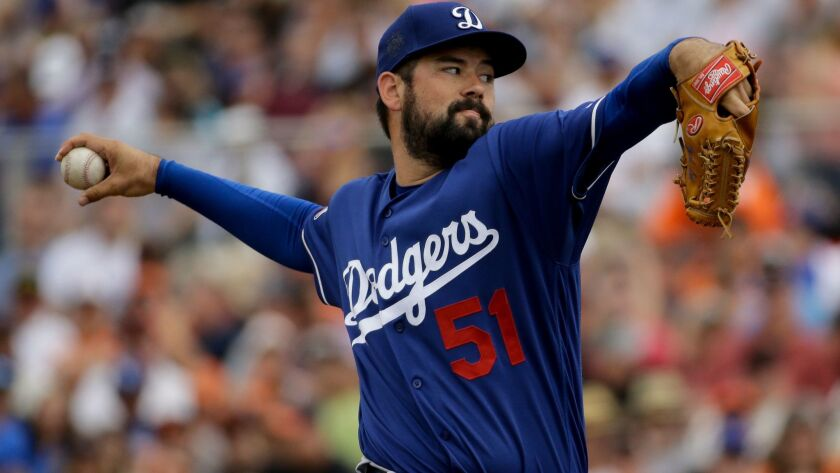 Los Angeles Dodgers starting pitcher Zach Lee throws against the San Francisco Giants during first inning of a spring baseball game in Scottsdale, Ariz., Sunday, March 6, 2016. (AP Photo/Chris Carlson)