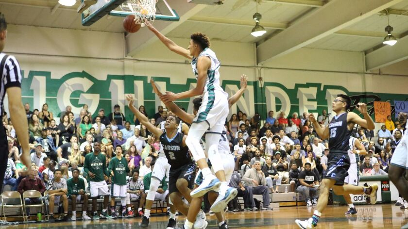 Helix's Miles Norris blocks a Carson shot in the Highlanders' SoCal Regional win over Carson.