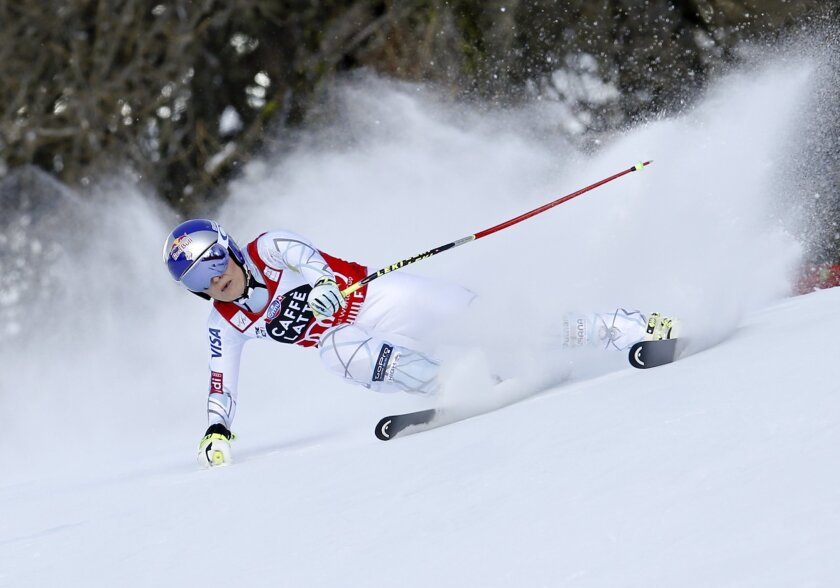 United States' Lindsey Vonn speeds down the slope before crashing during a women's Alpine ski downhill race, in La Thuile, Italy, Friday, Feb. 19, 2016. (AP Photo/Marco Trovati)