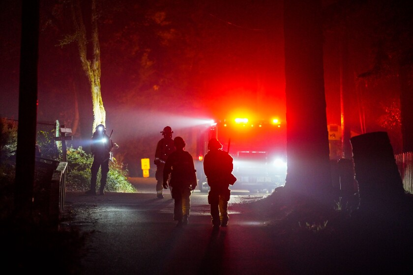 Firefighters respond to the CZU Lightning Complex fire in Boulder Creek last month.
