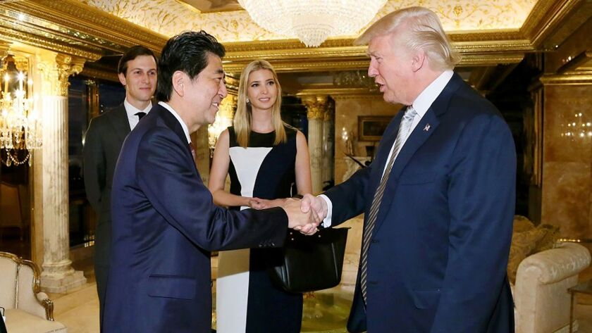 Japanese Prime Minister Shinzo Abe being welcomed by President-elect Donald Trump beside Ivanka Trump and her husband Jared Kushner in New York on November 17.
