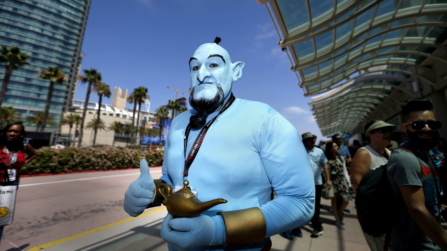 Fans dress up as their favorite characters Saturday at Comic-Con 2017.