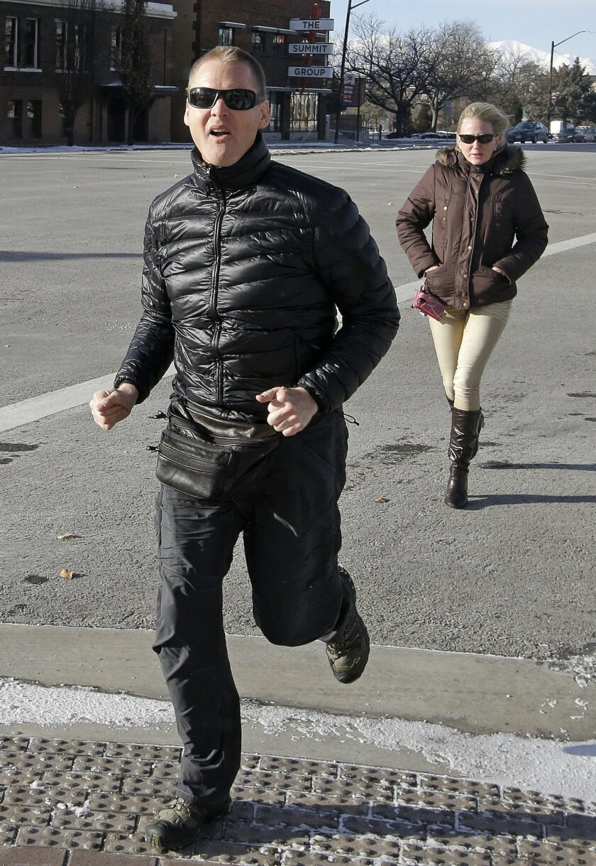"FILE - In this Dec. 2014, file photo, Dell ""Super Dell"" Schanze arrives for a court appearance at the federal courthouse in Salt Lake City. Schanze, a former TV pitchman in Utah accused of kicking a barn owl in flight while riding a motorized paraglider, is expected to enter a plea in the case. (AP Photo/Rick Bowmer, File)"
