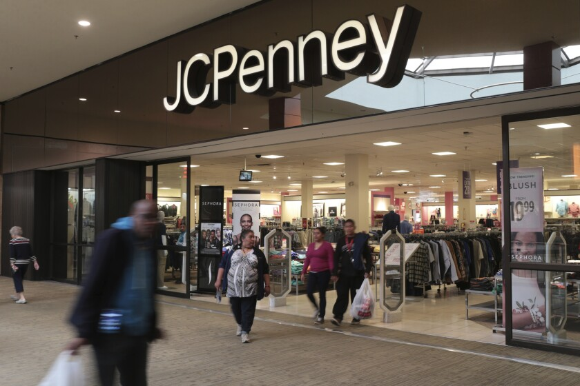 In this Friday, March 17, 2017, photo, shoppers exit a J.C. Penney store in the Georgia Square Mall in Athens, Ga.