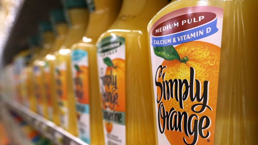SAN FRANCISCO, CA - MARCH 27: Containers of orange juice are displayed at Cal-Mart Grocery on March