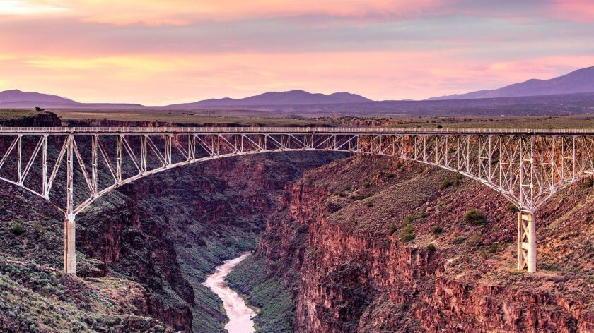 A colorful sky forms the backdrop to the bridge spanning the Rio Grande Gorge near Taos, New Mexico. ** OUTS - ELSENT, FPG, CM - OUTS * NM, PH, VA if sourced by CT, LA or MoD **