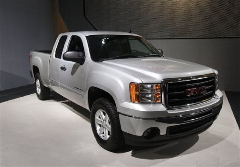 A GMC Sierra Z71 4x4 is shown on the exhibit floor at the North American International Auto Show in Detroit, Tuesday, Jan. 11, 2011. General Motors CEO Dan Akerson says the company fell a year behind in developing new models due to cuts made during GM's 2009 bankruptcy. The company delayed development of the next-generation Chevrolet Silverado and Sierra pickup trucks during its financial crisis. (AP Photo/Paul Sancya)