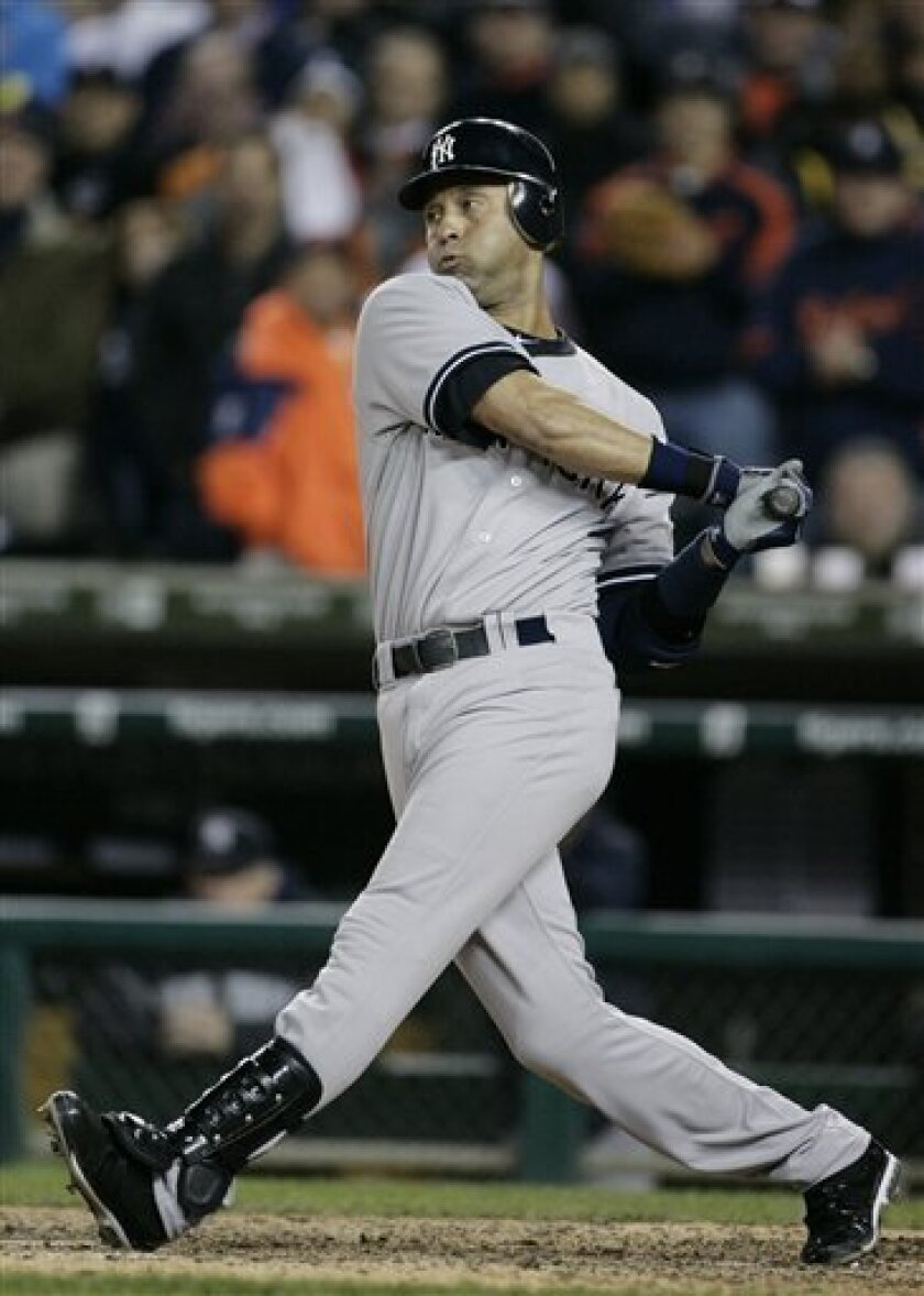 New York Yankees' Derek Jeter strikes out swinging to end the ninth inning of Game 3 of baseball's American League division series against the Detroit Tigers on Monday, Oct. 3, 2011, in Detroit. (AP Photo/Duane Burleson)