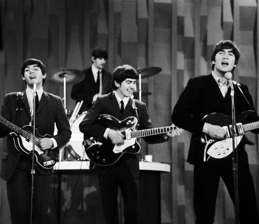 """FILE - In this Feb. 9, 1964 file photo, The Beatles , from left, Paul McCartney, Ringo Starr on drums, George Harrison and John Lennon, perform on the CBS """"Ed Sullivan Show"""" in New York. The Beatles made their first appearance on """"The Ed Sullivan Show,"""" America's must-see weekly variety show, on Sunday, Feb. 9, 1964. And officially kicked off Beatlemania. (AP Photo/Dan Grossi/ File)"""