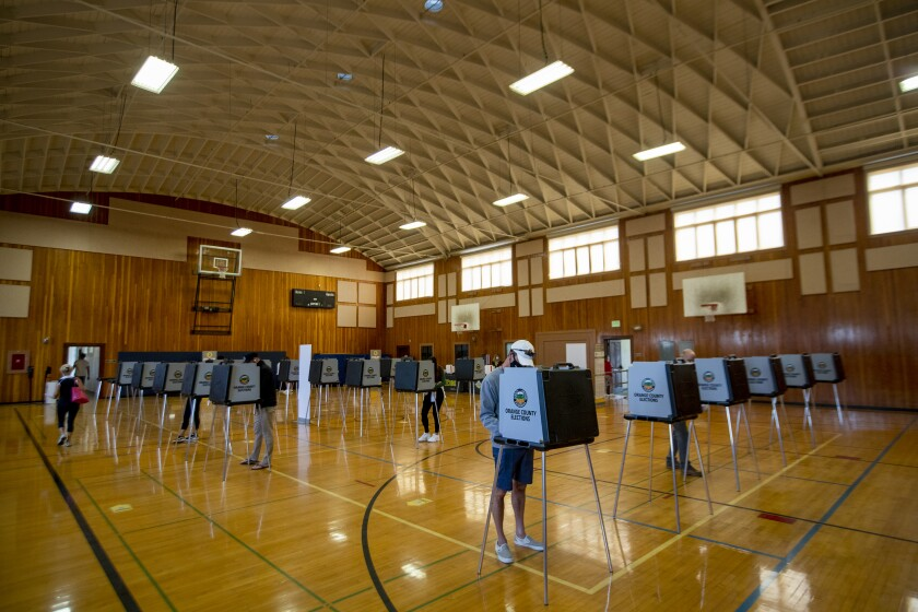 Voters cast their ballots at the Huntington Beach City Gym and Pool on Tuesday.