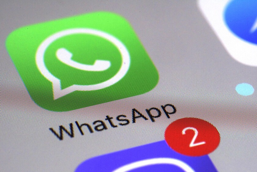 FILE - This March 10, 2017 file photo shows the WhatsApp communications app on a smartphone, in New York. Ireland's privacy watchdog said Thursday Sept. 2, 2021, it has fined WhatsApp a record 225 million euros ($267 million) after an investigation found it breached stringent European Union data protection rules on transparency about sharing people's data with other Facebook companies. (AP Photo/Patrick Sison, File)