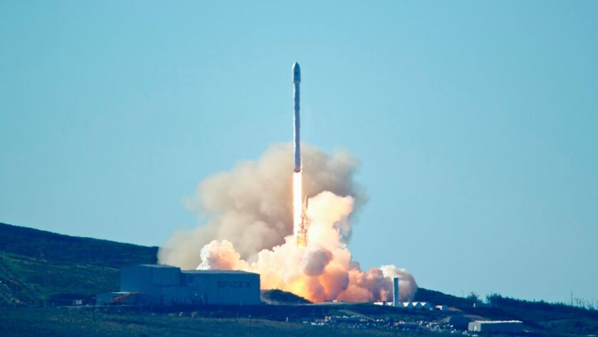 SpaceX's Falcon 9 rocket, carrying 10 satellites, lifts off from Vandenberg Air Force Base on Jan. 14, 2017.