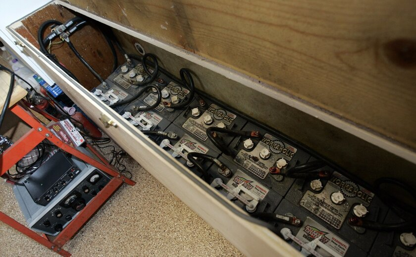 Bruce Haupt has a closet of batteries used to power his home during an emergency.  John Gastaldo/Union-Tribune