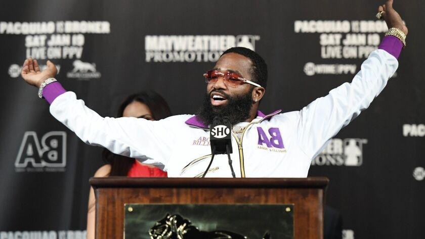 Adrien Broner stretches as he takes the podium to speak at a news conference at MGM Grand Hotel & Casino on Wednesday in Las Vegas. Broner will challenge Manny Pacquiao for his title on Saturday.