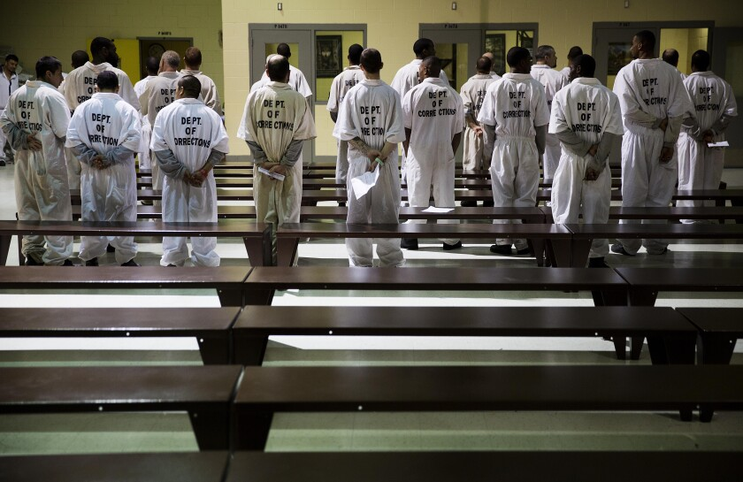 FILE - In this Dec. 1, 2015, file photo prisoners stand while being processed for intake at the Georgia Diagnostic and Classification Prison in Jackson, Ga. The U.S. Department of Justice on Tuesday, Sept. 14, 2021, announced a statewide civil rights investigation into Georgia prisons, citing particular concern about violence. (AP Photo/David Goldman)