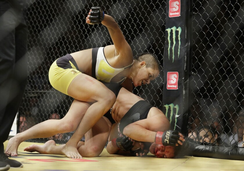 Amanda Nunes, left, fights Miesha Tate during their women's bantamweight championship mixed martial arts bout at UFC 200, Saturday, July 9, 2016, in Las Vegas. (AP Photo/John Locher)