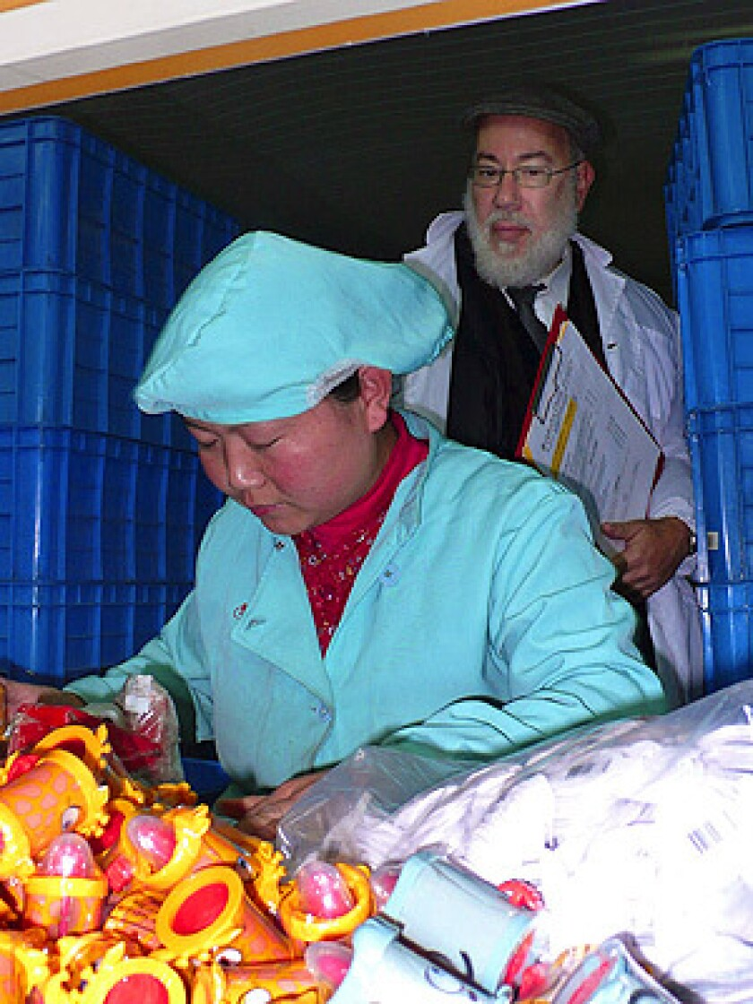 Rabbi Martin Grunberg is one of a small group of kosher food inspectors who watches over factory workers in China, the world's fastest-growing producer of kosher-certified products. Here he is on a maintenance tour of a Chinese candy factory making kosher-certified toy candies, most of it for export to the U.S. and Israel.