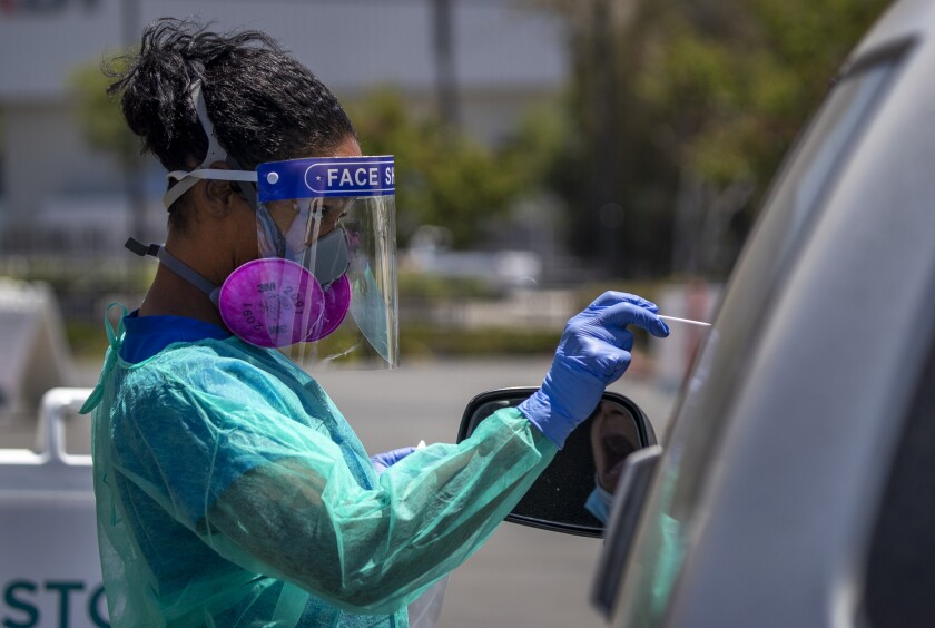 Nurse Maritza Perez giving a COVID-19 test to a patient at AltaMed Health Services in Anaheim on July 9.