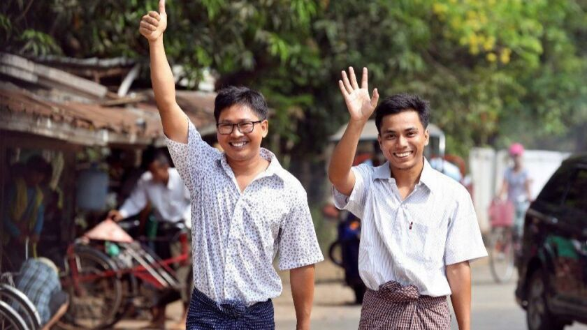 Reuters journalists Wa Lone, left, and Kyaw Soe Oo walk out of Insein prison May 7 in Yangon, Myanmar.