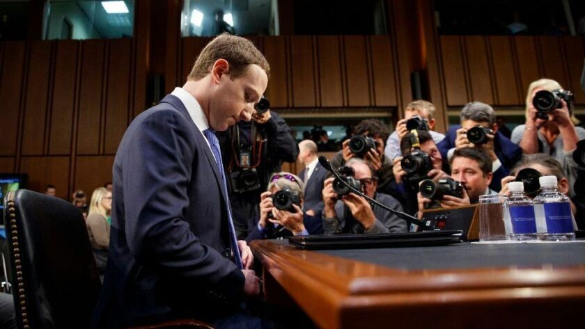 Facebook CEO Mark Zuckerberg at a congressional hearing last April.