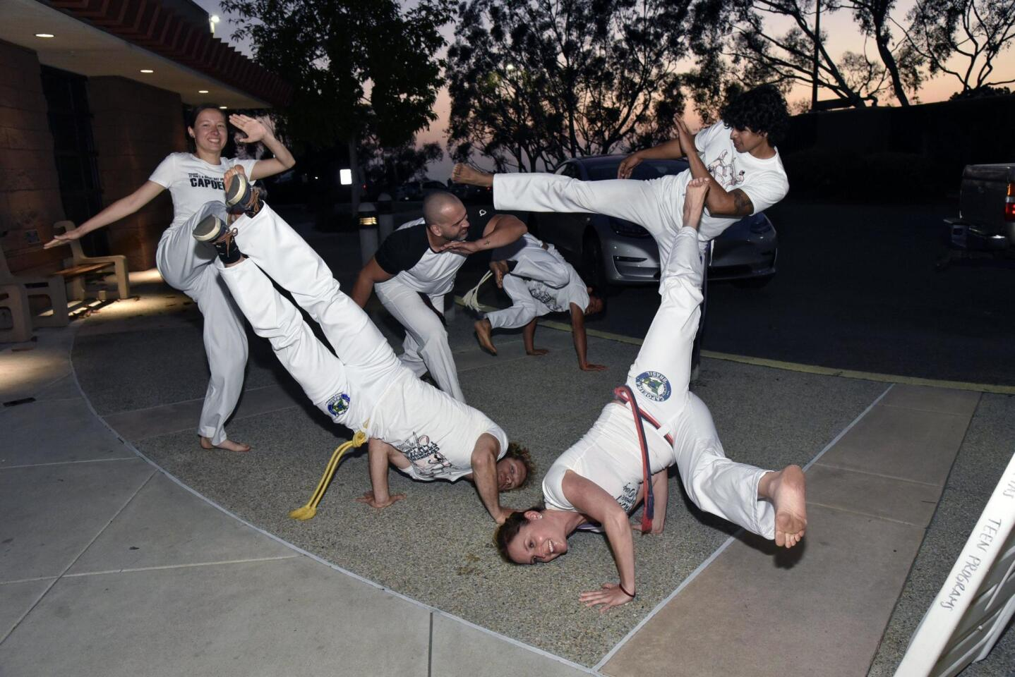 Capoeira Brazil San Diego performers warm up prior to performing