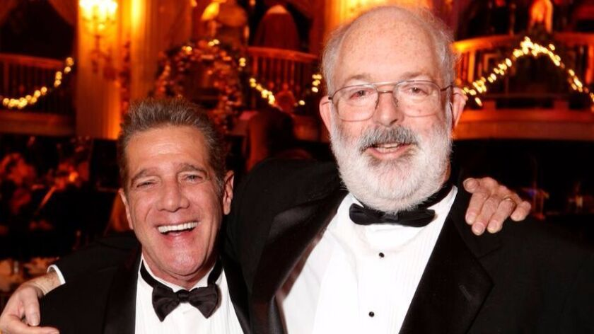 Glenn Frey (left) and Jack Tempchin are shown in 2013 in Los Angeles at the 27th annual Charles Dick
