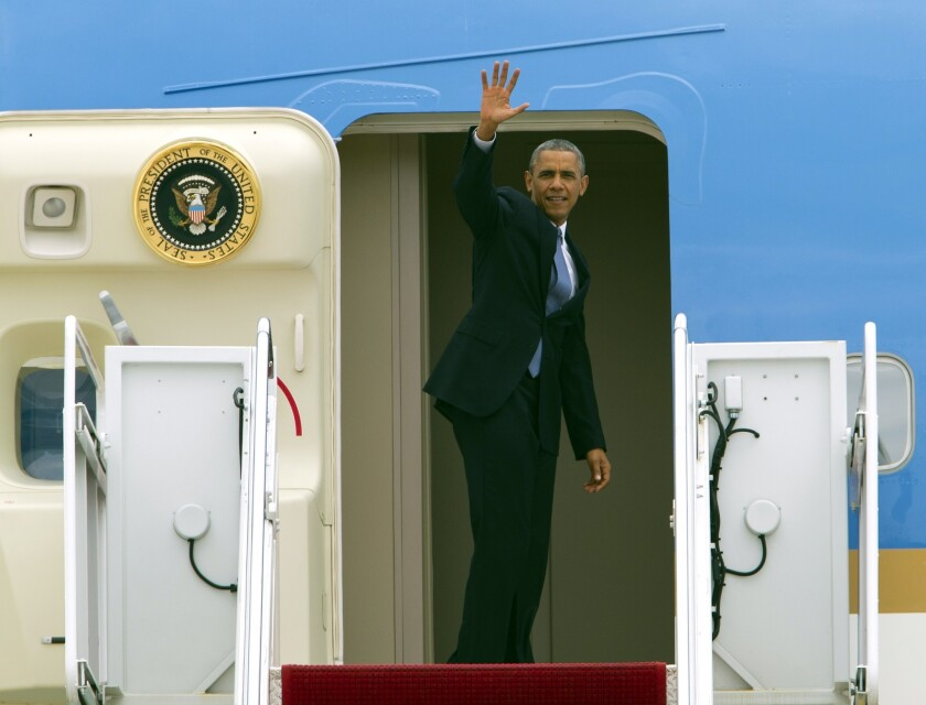 President Obama waves from Air Force One before departure at Andrews Air Force Base in Maryland. He was flying to Seattle for a three-day West Coast trip and will attend at least five fundraising events in Seattle, San Francisco and Los Angeles.