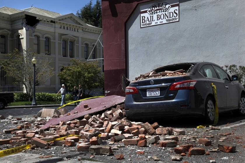 A 6.0 earthquake sent bricks falling from a Napa business onto a car early Sunday.
