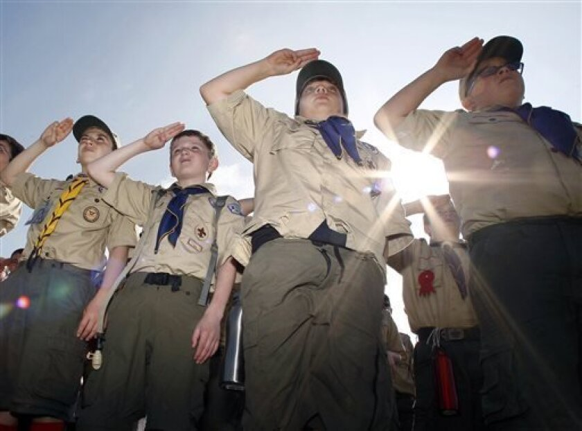 Boy Scouts salute early Saturday morning, May 21, 2011 during New Jersey's Boy Scouts Camporee in Sea Girt, N.J.