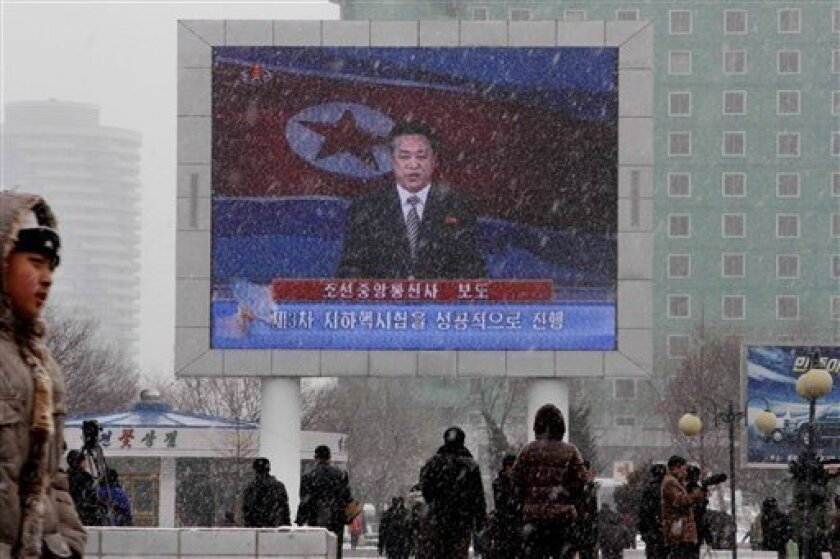 On a large television screen in front of Pyongyang's railway station, a North Korean state television broadcaster announces the news that North Korea conducted a nuclear test on Tuesday, Feb. 12, 2013. North Korea conducted a nuclear test at an underground site in the remote northeast Tuesday, taki