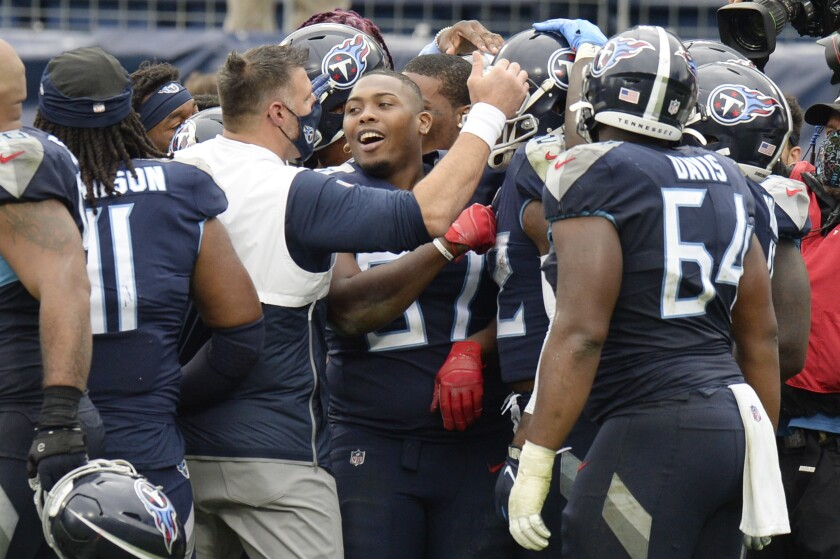 Tennessee Titans head coach Mike Vrabel celebrates with his players after beating the Houston Texans in overtime of an NFL football game Sunday, Oct. 18, 2020, in Nashville, Tenn. The Titans won 42-36. (AP Photo/Mark Zaleski)