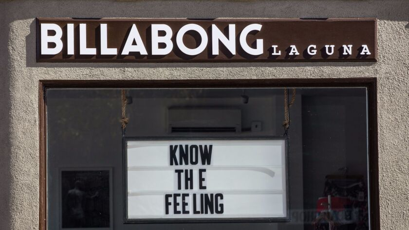 Billabong in Laguna Beach recently put up a sign that is similar to one that business owner Melissa Martinez tried to get approved for her business but was denied.