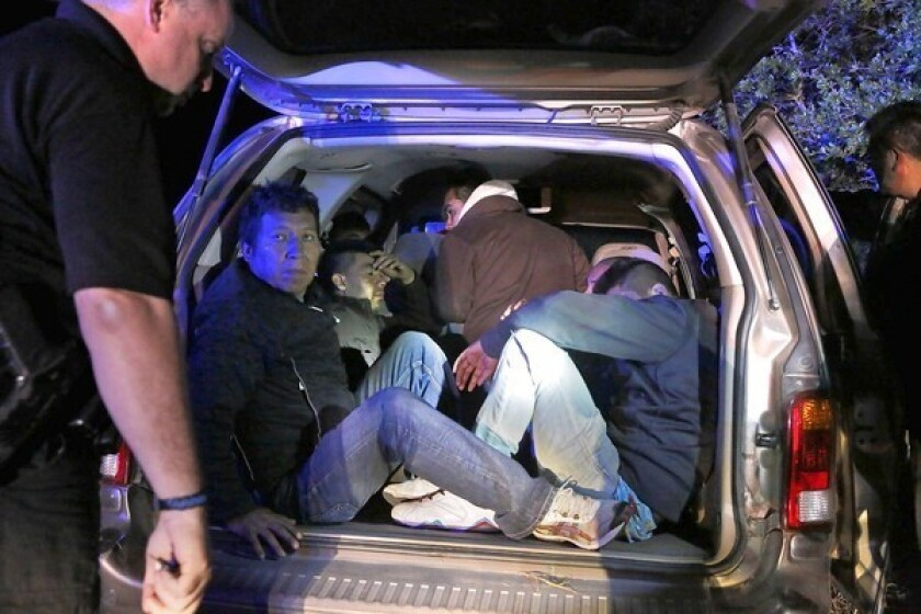 Brooks County sheriff's deputies stop a vehicle carrying Mexicans suspected of crossing illegally in Falfurrias, Texas. A Senate proposal to tighten border security calls for doubling Border Patrol officers, 700 miles of border fencing and drone surveillance flights.