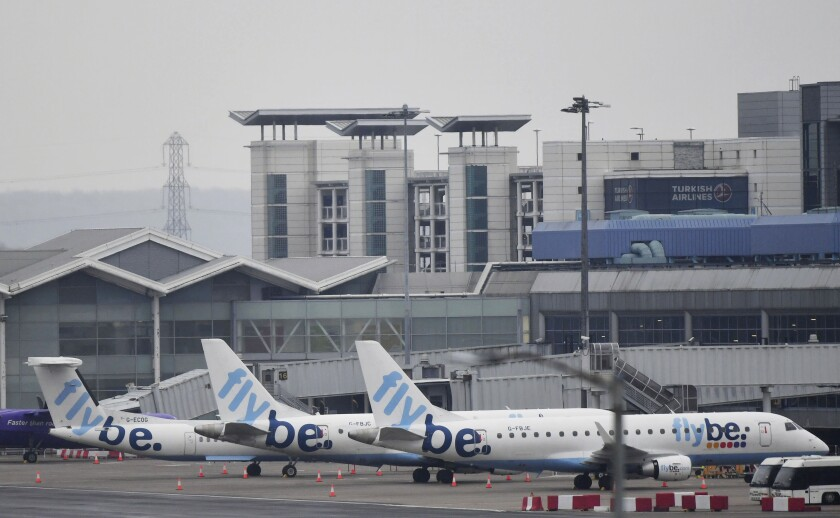 Flybe passenger planes are parked at Birmingham Airport, as Flybe, Europe's biggest regional airline, has collapsed into administration, in Birmingham, England, Thursday March 5, 2020. UK Civil Aviation Authority (CAA) said Thursday that financially troubled Flybe had entered administration, leaving passengers stranded and told to find their own way home. (Jacob King/PA Wire( / PA via AP)