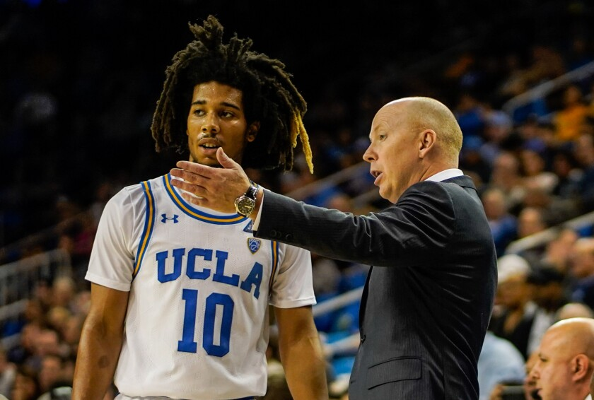 UCLA coach Mick Cronin talks to guard Tyger Campbell