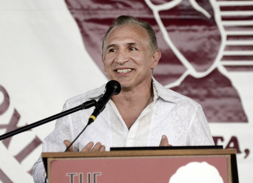 International Boxing Hall of Fame inductee, Ray Mancini, smiles while giving his induction speech during the International Boxing Hall of Fame Induction ceremony in Canastota, N.Y., Sunday, June 14, 2015. (AP photos/Heather Ainsworth)