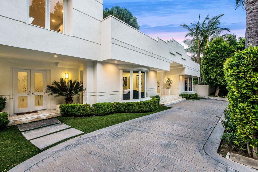 The Beverly Hills home of fashion designer Dina Bar-El features a sleek modern floor plan, high ceilings and new designer wood floors.