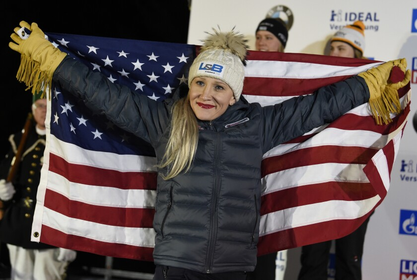 FILE - Gold medalist Kaillie Humphries of the United States celebrates during the medal ceremony for the two-woman bobsled competition at the Bobsleigh and Skeleton World Championships in Altenberg, Germany, in this Saturday, Feb. 22, 2020, file photo. Humphries will seek a record fourth women's bobsled world championship this weekend in Altenberg. (AP Photo/Jens Meyer, File)