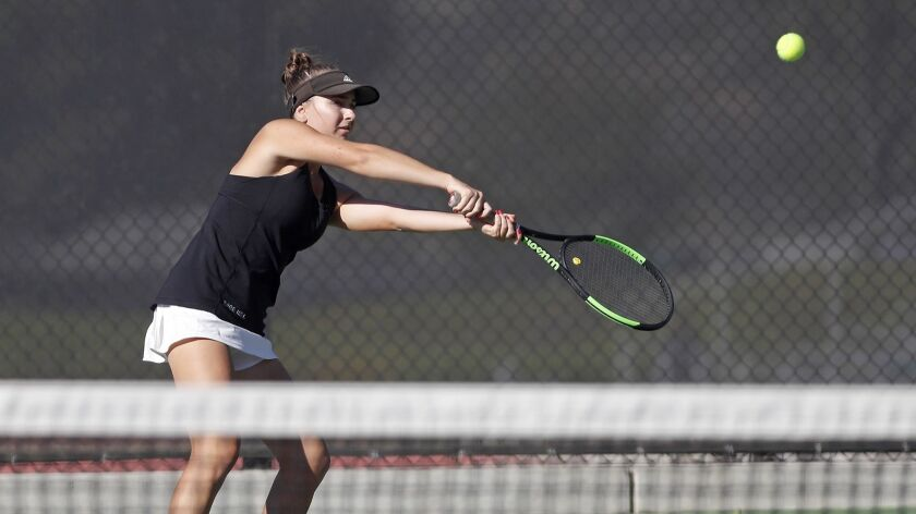 Sage Hill School's Miranda deBruyne plays in a No. 1 doubles set against St. Margaret?s during a San