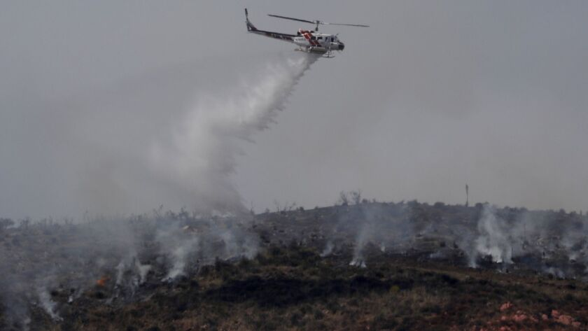 Aircraft work to douse the Stone fire in Agua Dulce, which grew to about 1,400 acres and was 30% contained Tuesday morning.